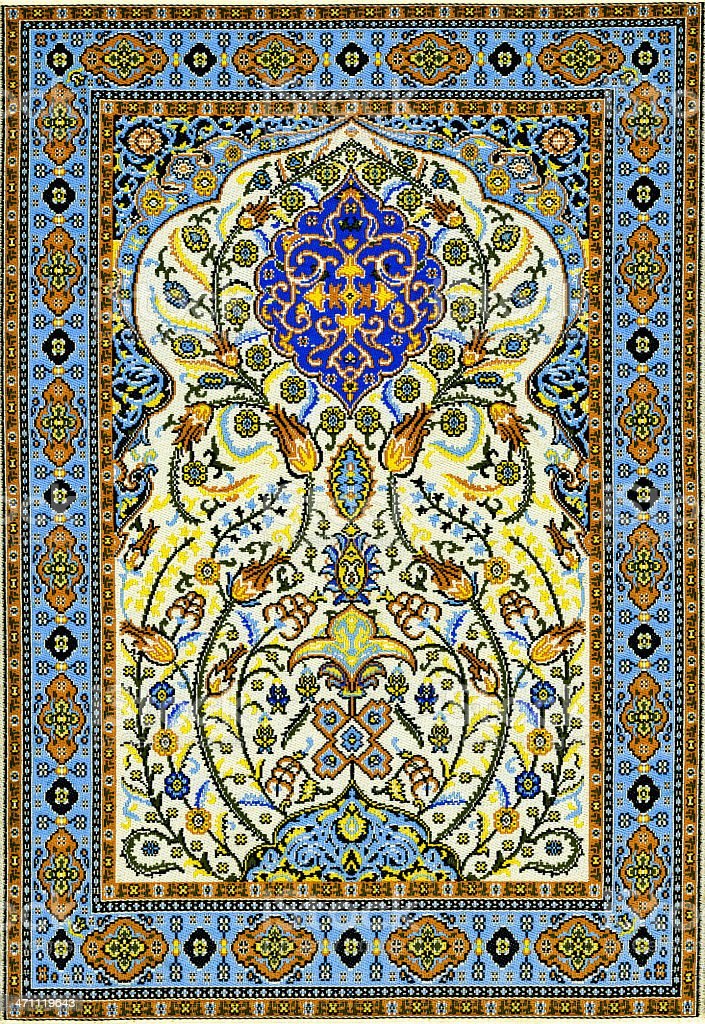 An Oriental style rug with a blue and cream floral pattern royalty-free stock photo