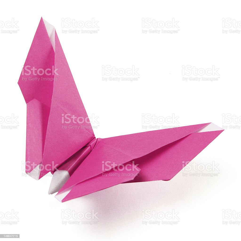 An origami of a butterfly made of pink paper stock photo
