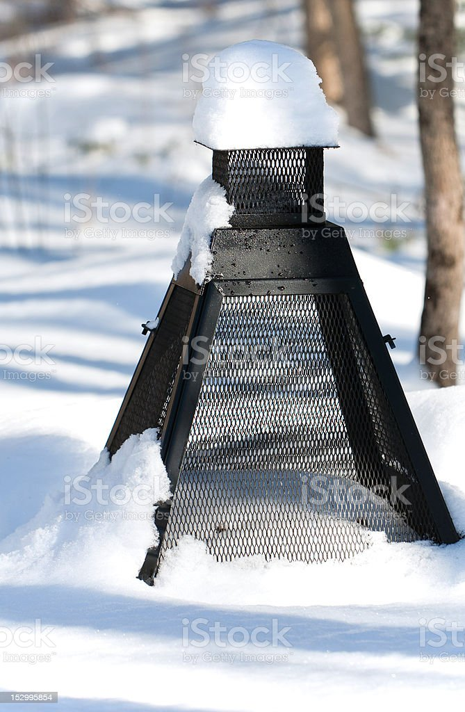 An Outdoor Fireplace after the Snowstorm. stock photo