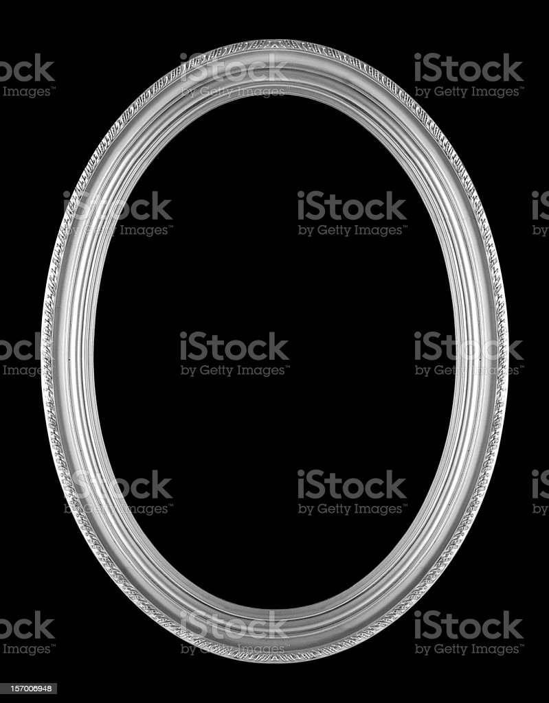An oval picture frame on a black background stock photo