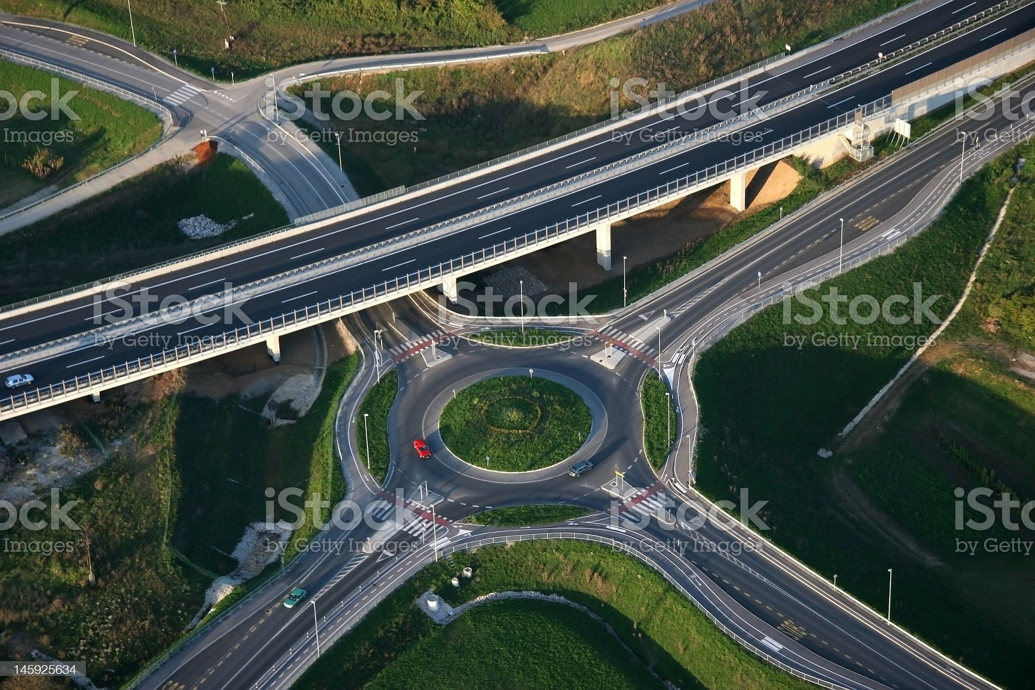 An overhead view of a roundabout and motorways royalty-free stock photo