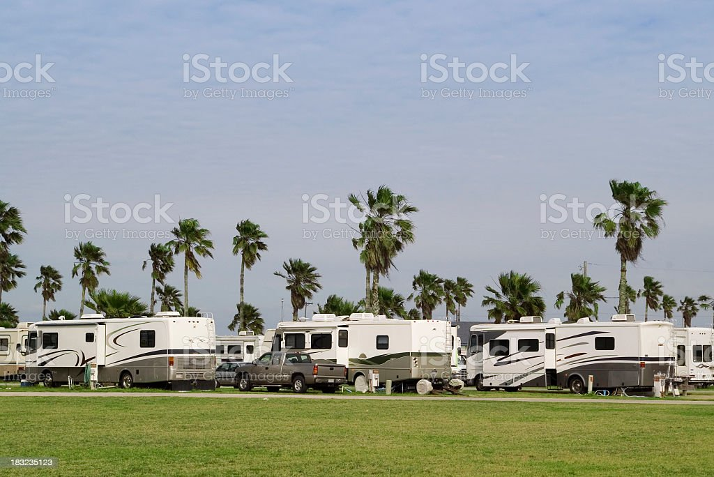 An RV park with the same RVs all in a row stock photo