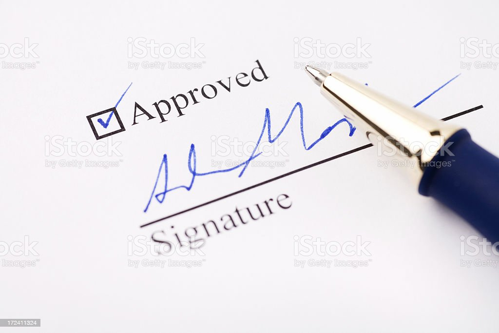 An signature under an approved check mark stock photo
