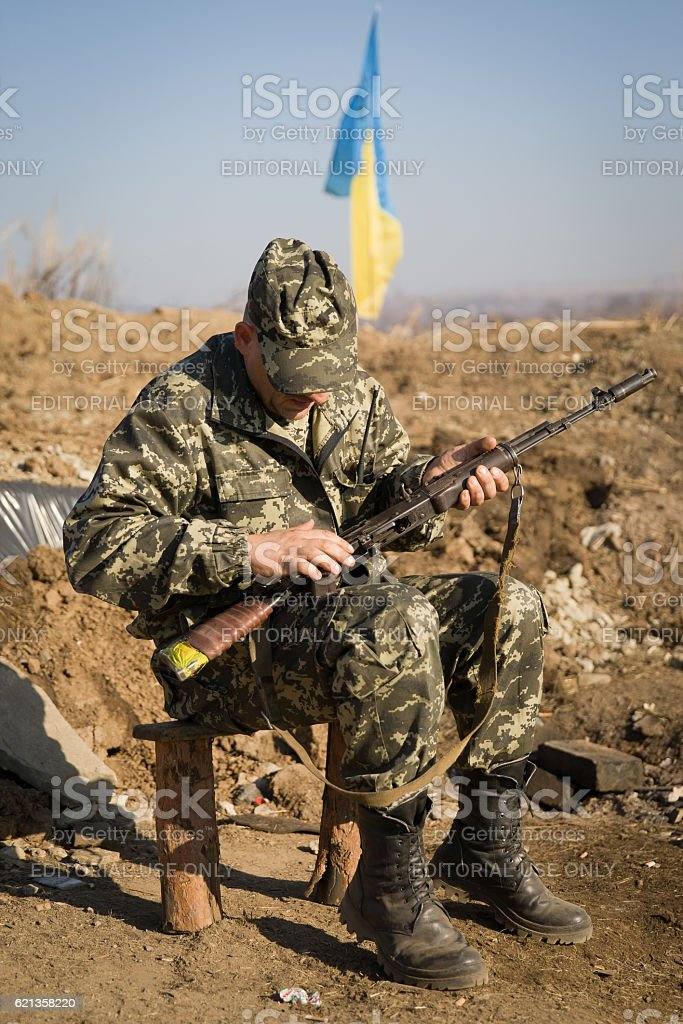An soldier with a Kalashnikov stock photo