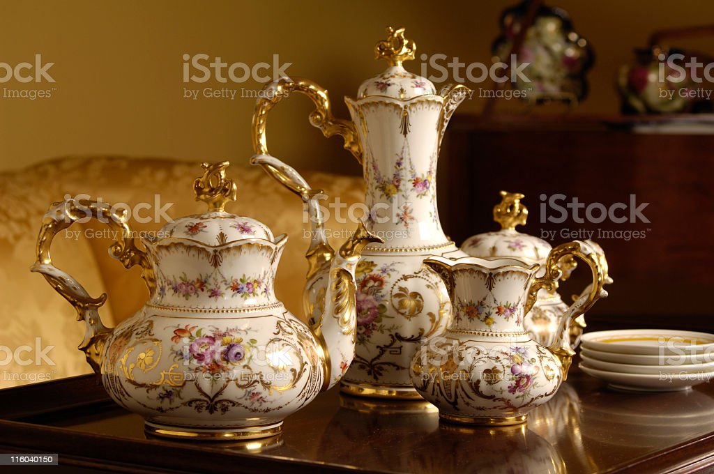 An table with an antique tea and coffee set on top stock photo