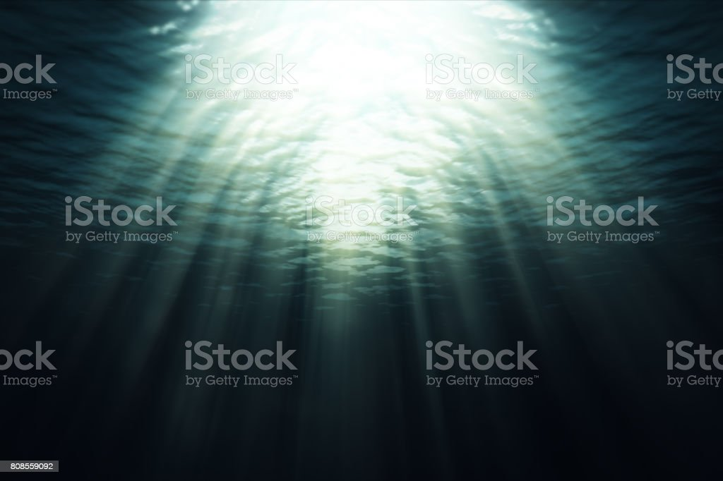 An underwater scene animated with fractal waves and light rays stock photo