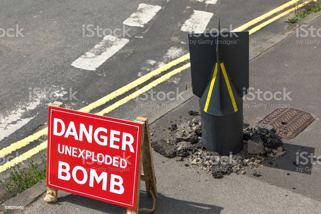 An unexploded bomb in a street. stock photo
