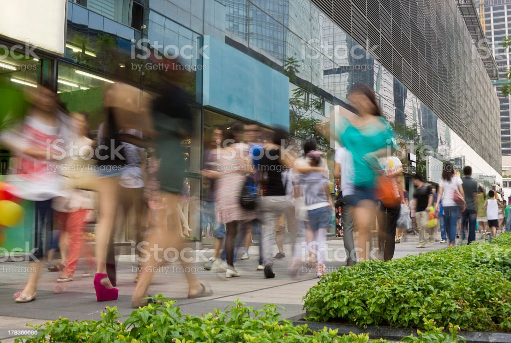 An unfocused image of a busy shopping center stock photo