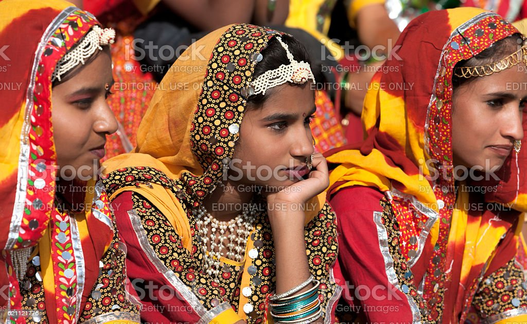 An unidentified girls  in colorful ethnic attire, India. stock photo