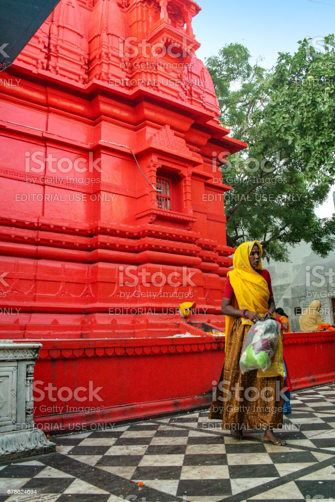 An unidentified Indian Rajasthani woman performs temple rituals at Pushkar stock photo