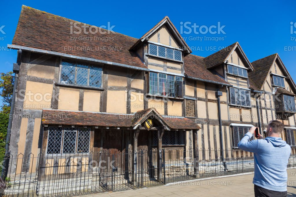 An unidentified man takes a picture of Shakespeare's birth house in Stratford-upon-Avon, United Kingdom on April 7th, 2017 stock photo