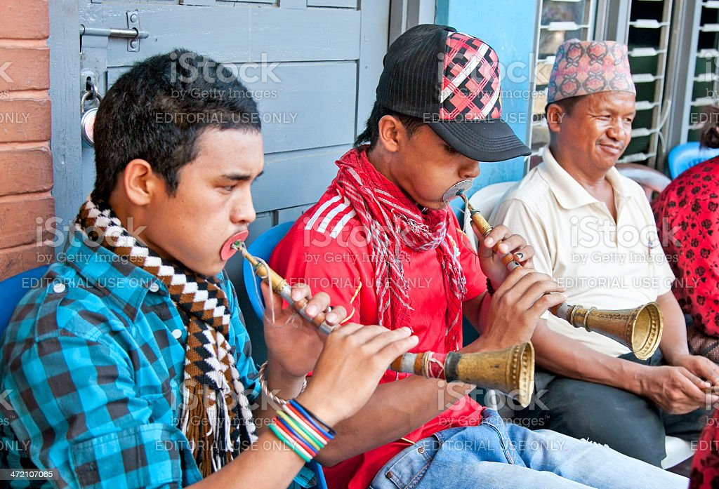 An unidentified Nepalese street musicians play brass trumpet stock photo