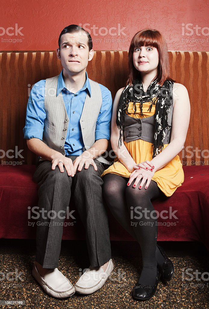 An unlike couple out on their first date stock photo