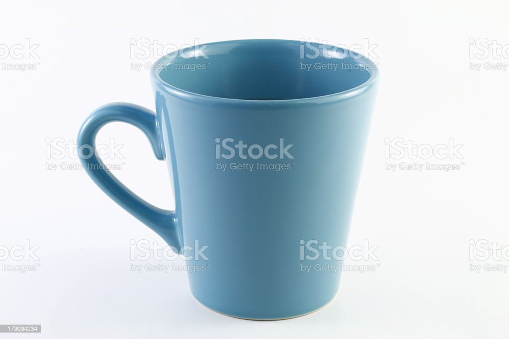 An unmarked baby blue cup on an isolated white background royalty-free stock photo