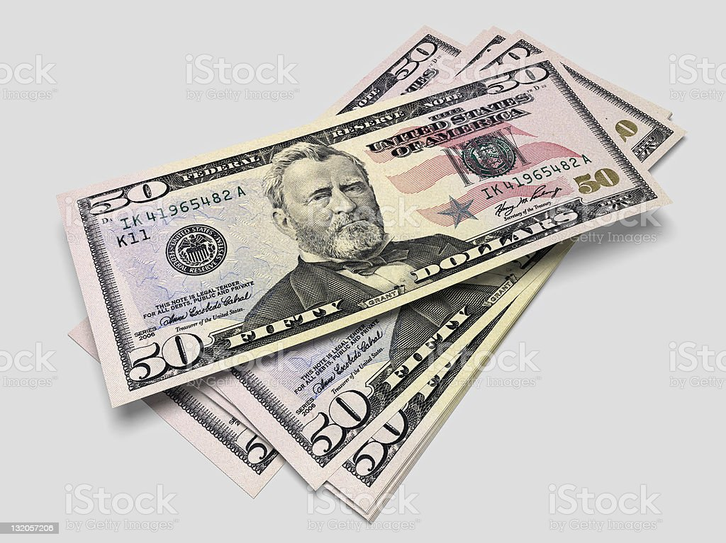 An untidy pole of fifty dollar notes stock photo