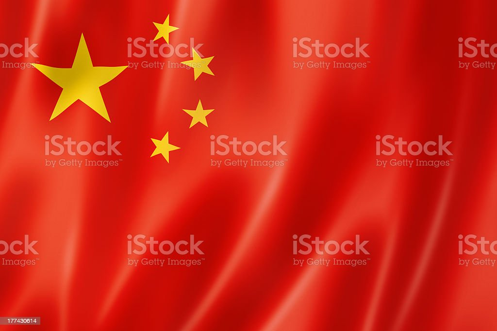 An up close image of a chinese flag with waves stock photo