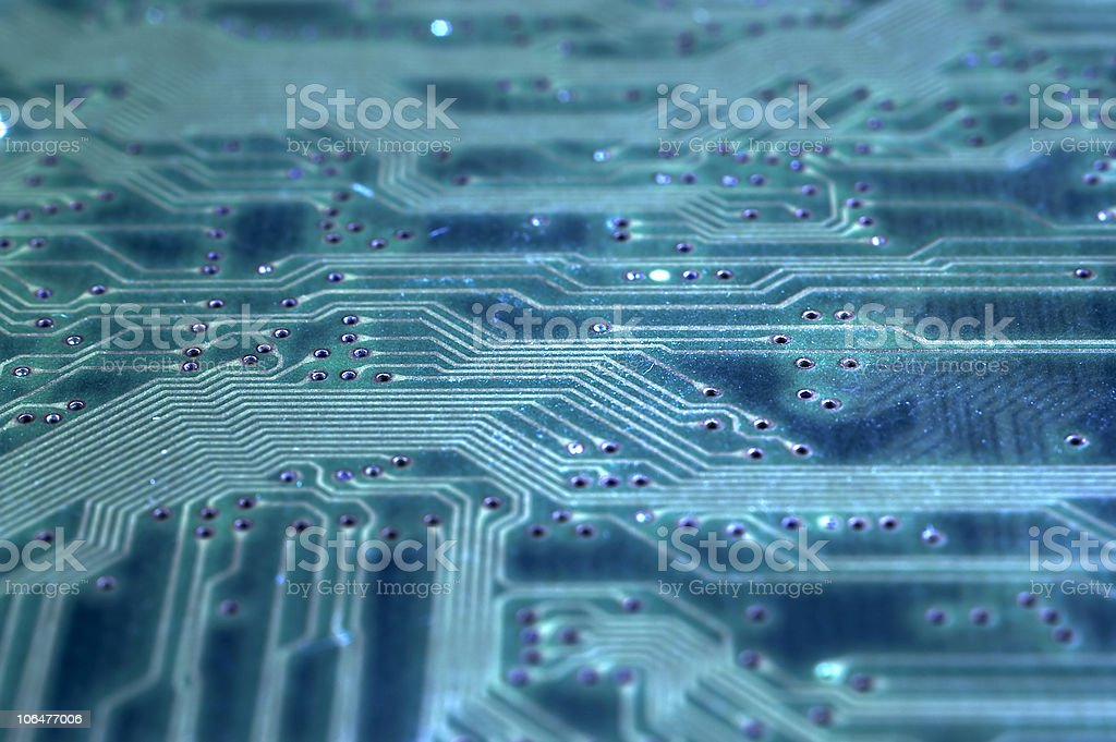 An up close image of a circuit board in blue stock photo