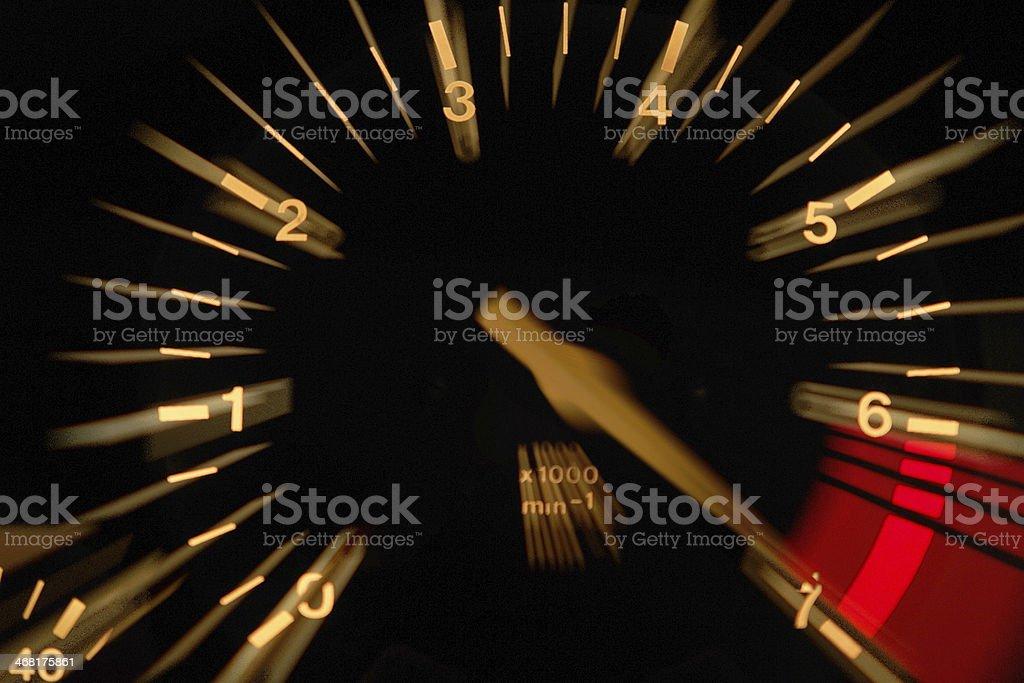 An up close image of a tachometer stock photo