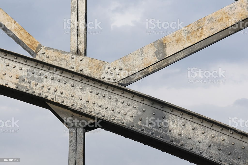 An up close image of the beams holding up a steel bridge stock photo