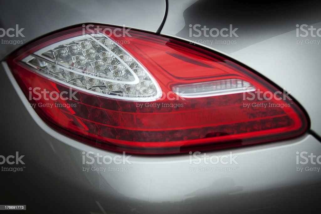 An up close photo of a rear light on car stock photo