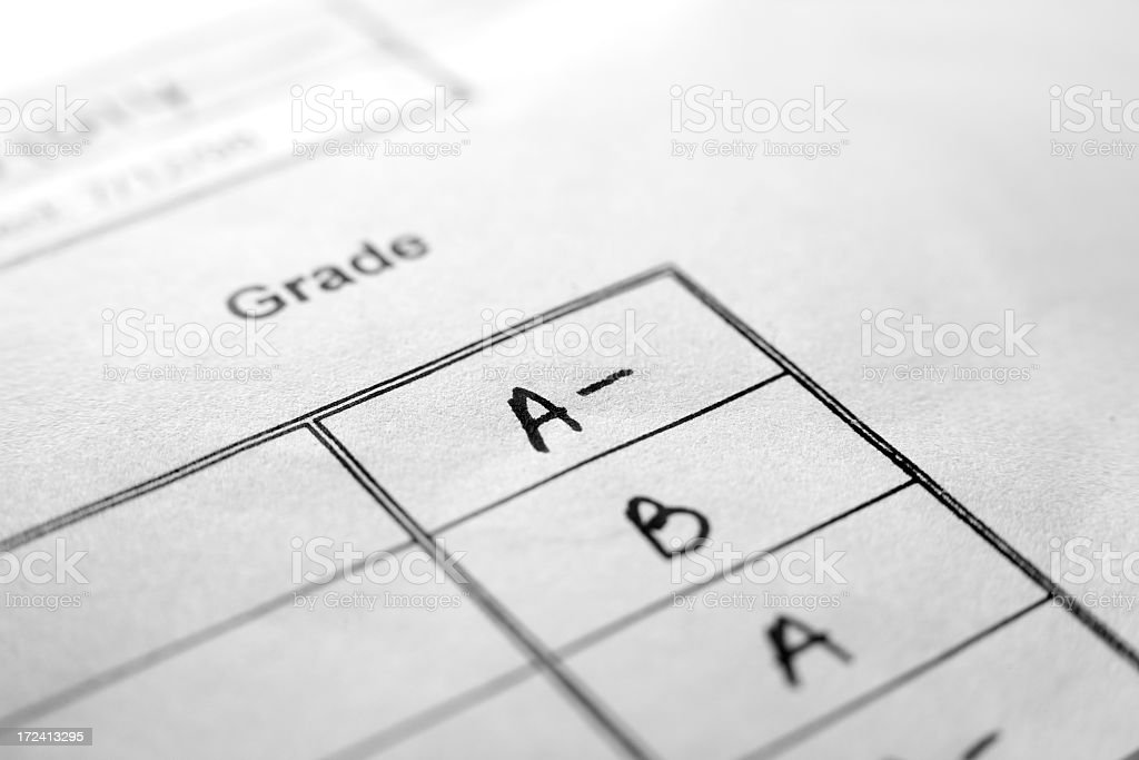 An up close picture of report card grades stock photo