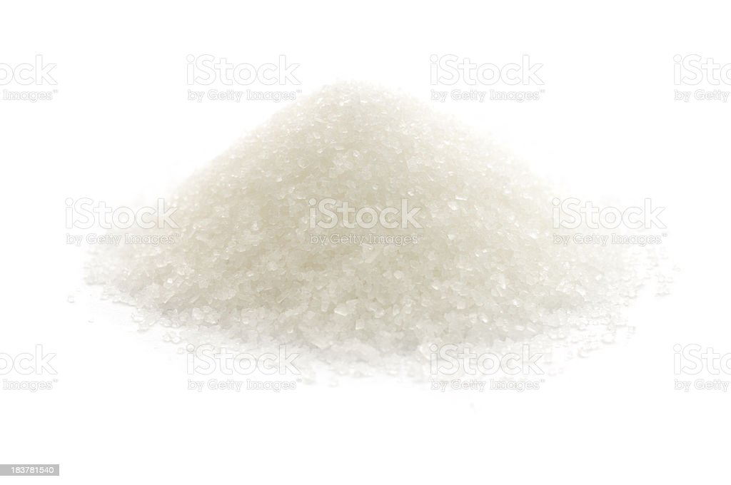 An up close picture of sugar on a white background stock photo
