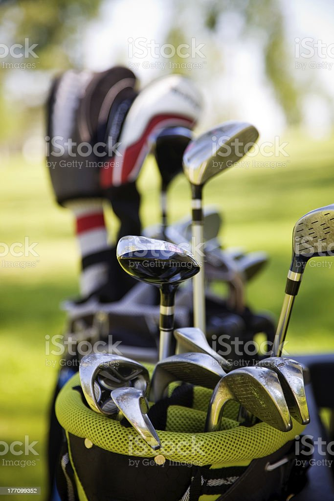 An up close view of a bag of golf clubs outdoors  stock photo