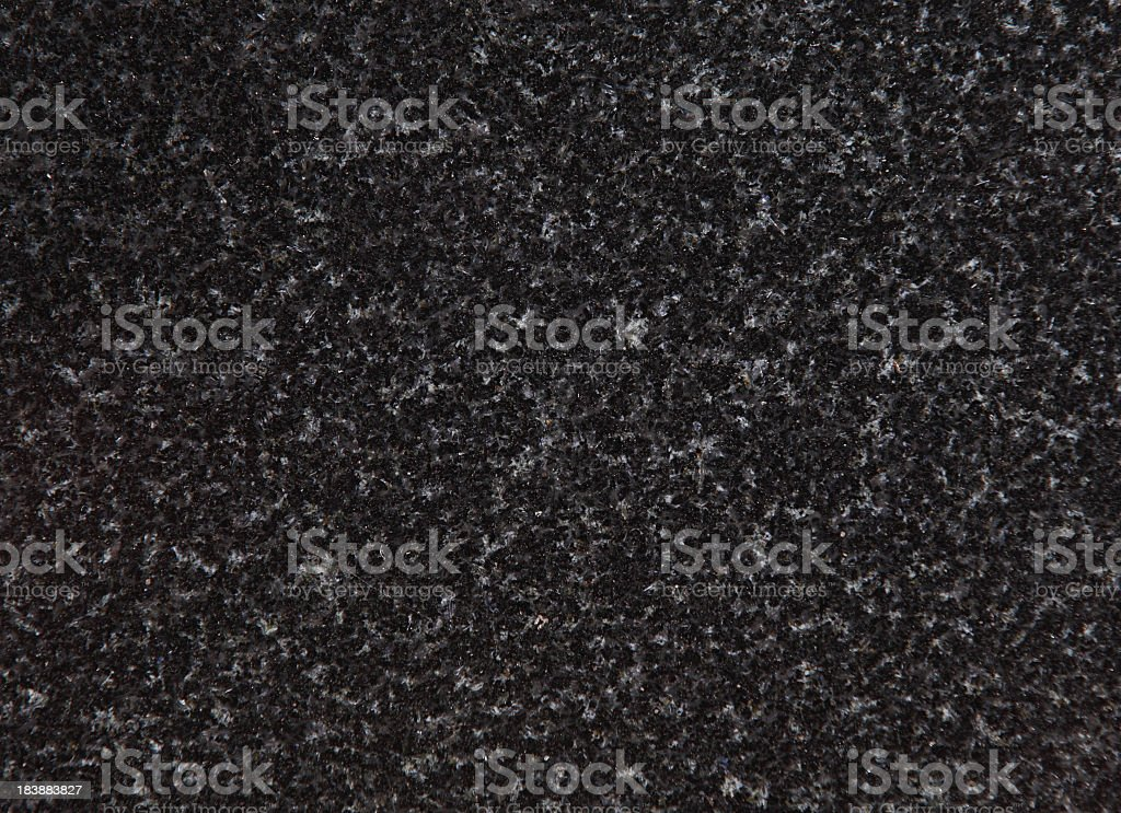 An up close view of black and grey speckled granite  stock photo