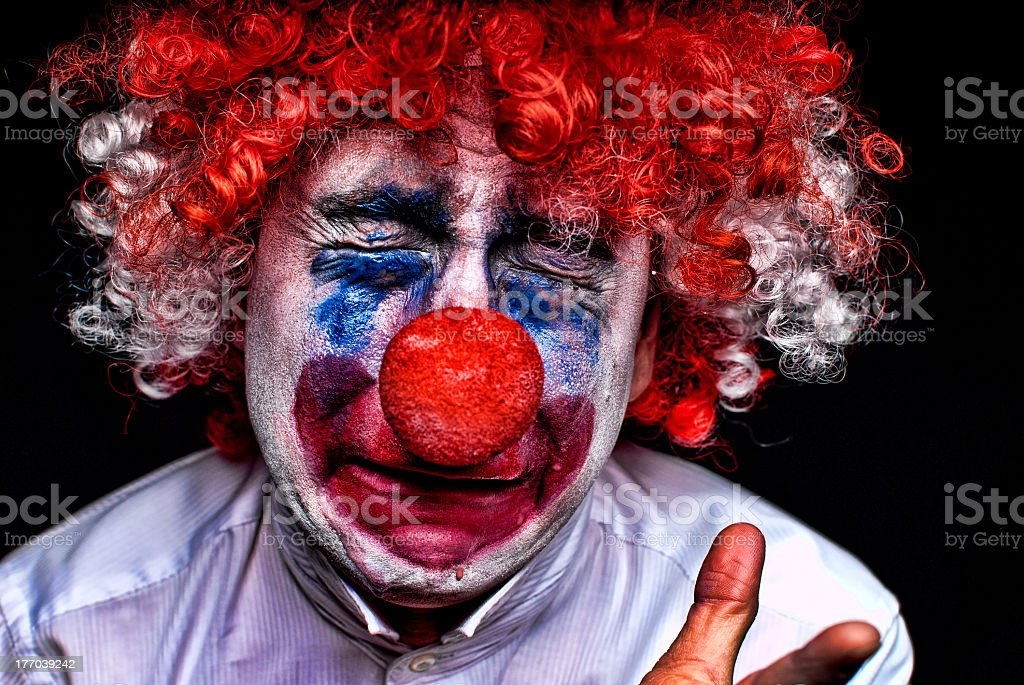 An upset clown with smudged make up stock photo