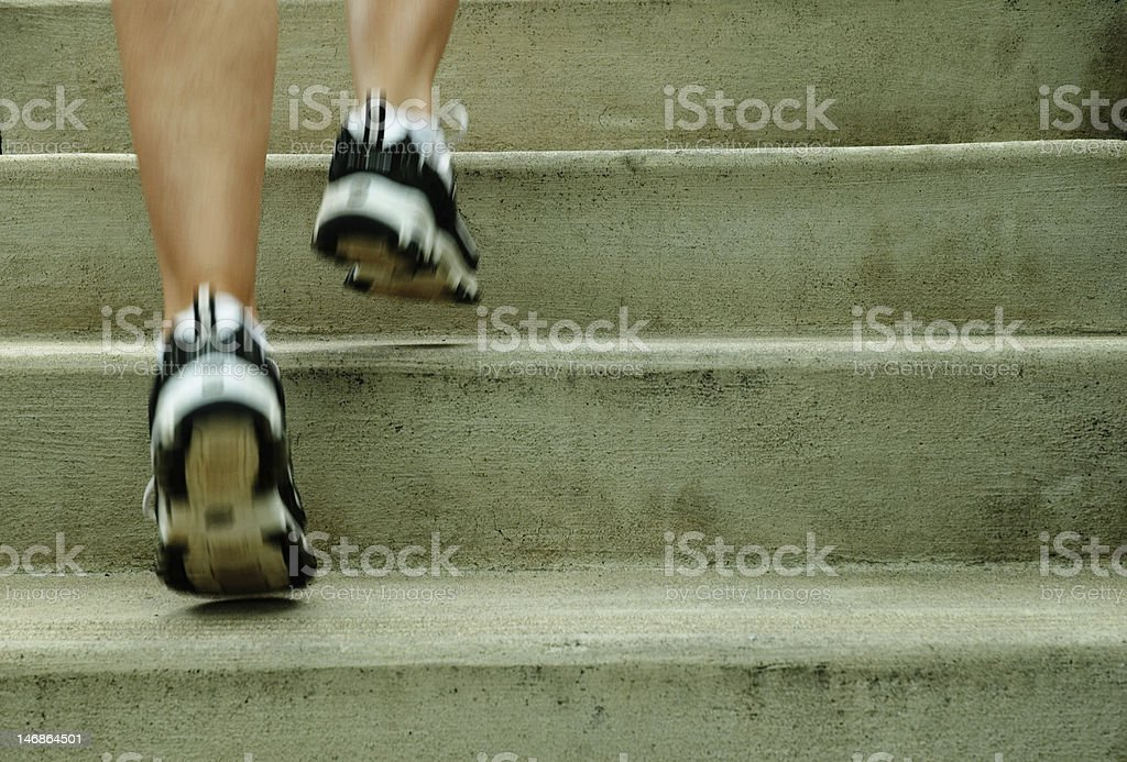 An urban runner in stylish shoes royalty-free stock photo