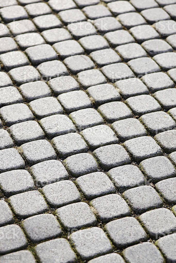 An urban street paved with square stones. royalty-free stock photo