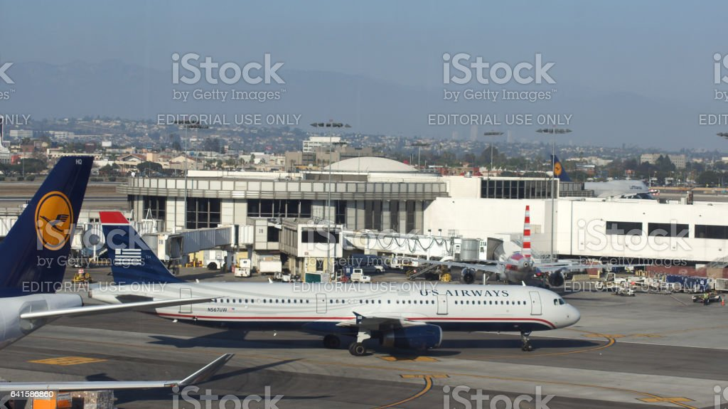 LOS ANGELES, CALIFORNIA, UNITED STATES - OCT 8, 2014: An US Airways Airbus A320 plane parked at LA International Airport LAX stock photo