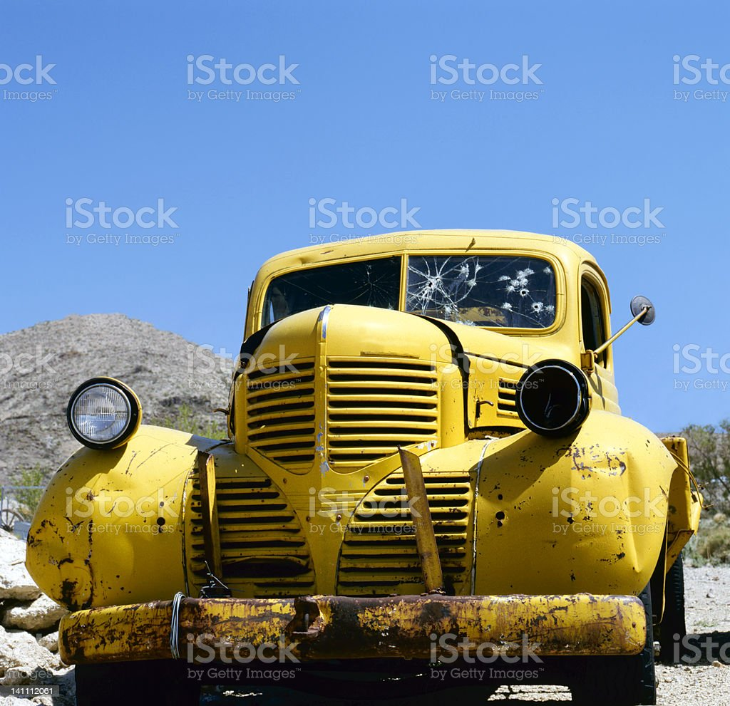 An yellow abandoned Bonnie and Clyde vehicle stock photo