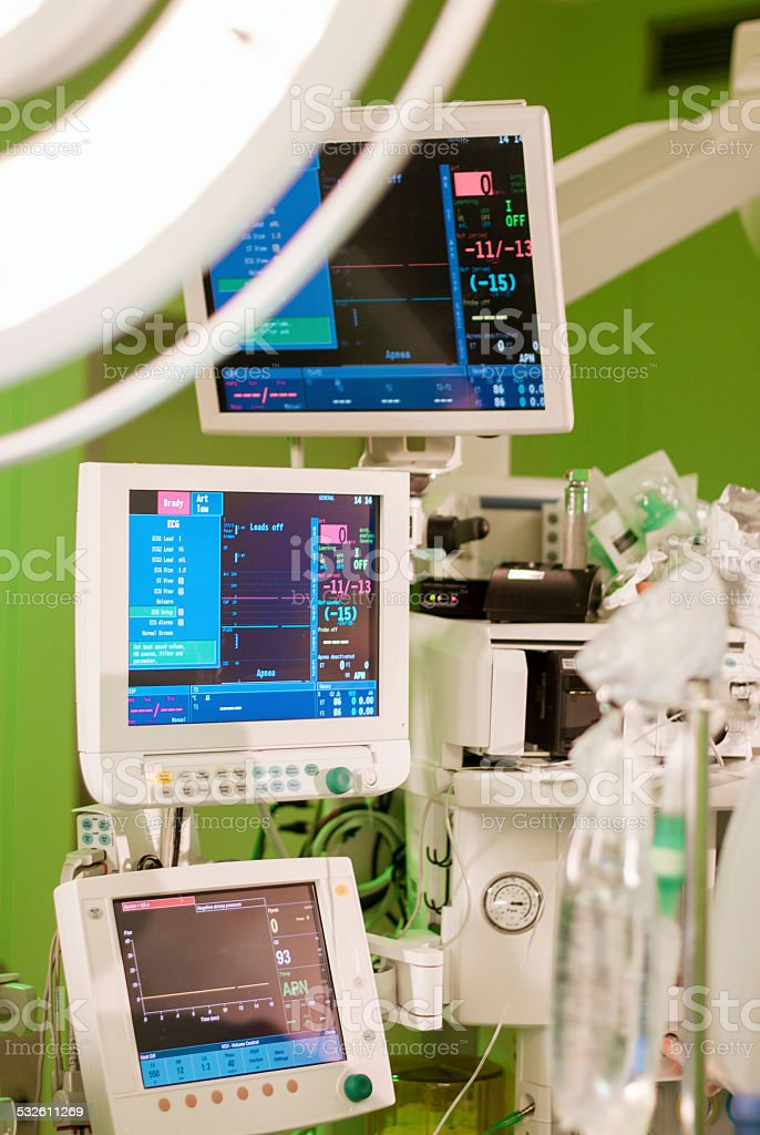 anaesthesiolog monitors in operation surgery room with green lights on stock photo
