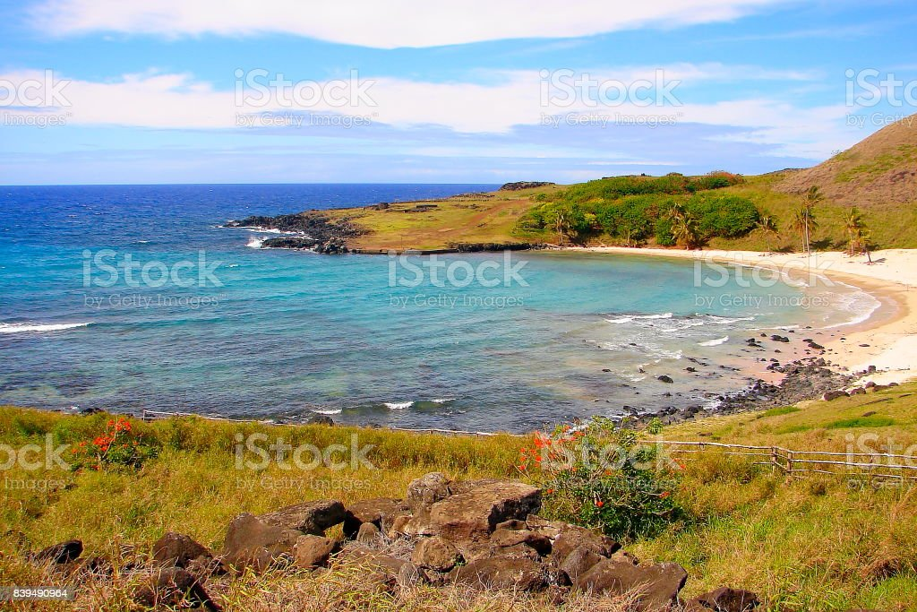 Anakena Beach and Impressive Easter Island, dramatic coastline shore: blue waves splashing on the rocks formation cliffs - Rapa Nui ancient civilization -  Idyllic pacific ocean at dramatic sunset, dramatic landscape panorama – Chile stock photo