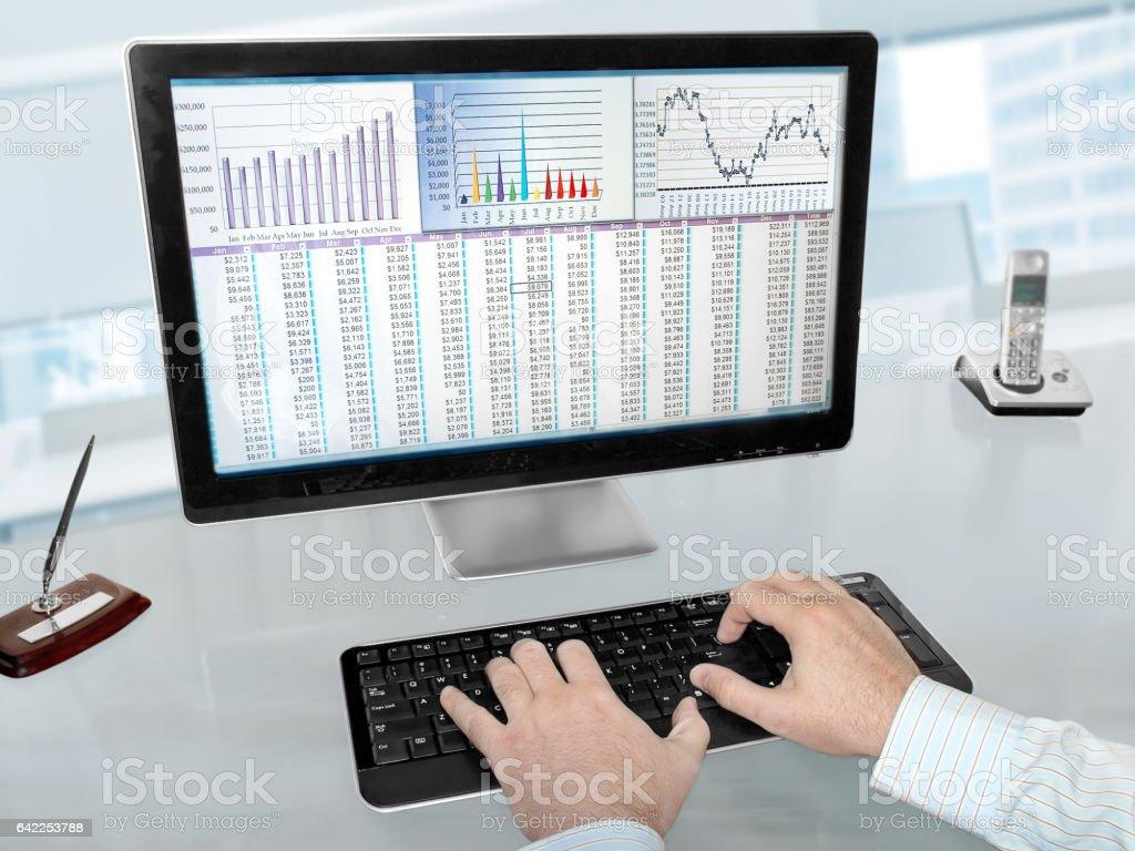 Analizing Data on Computer stock photo