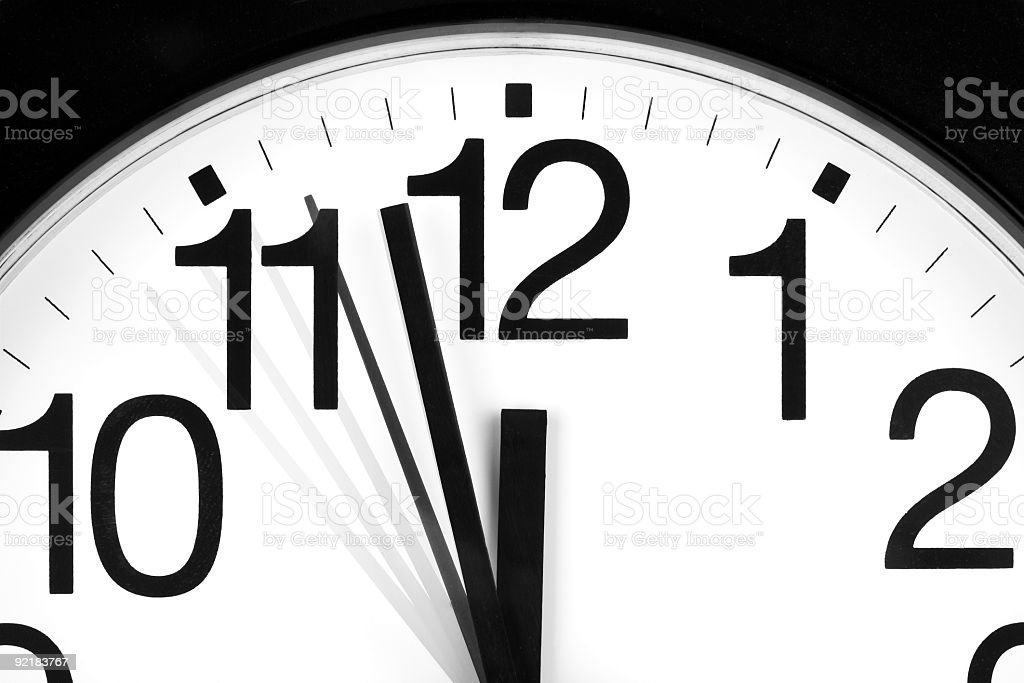 Analog clock showing the time of 1157 and 56 seconds royalty-free stock photo