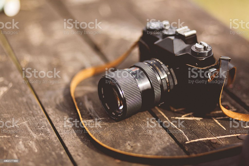 analog film camera on the table stock photo