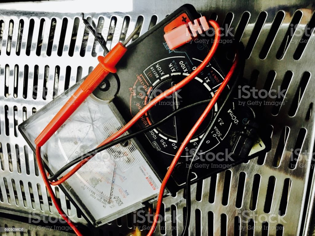 Analog Multimeter or Electrical Tester with Connected Probes stock photo