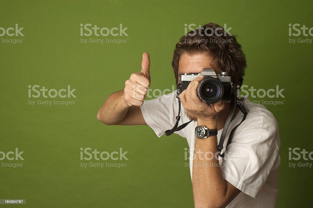 analog photo machine and young photographer stock photo