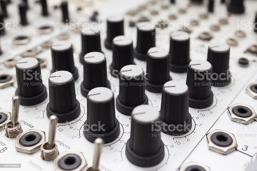 analog synthesizer , knobs macro on music equipment stock photo