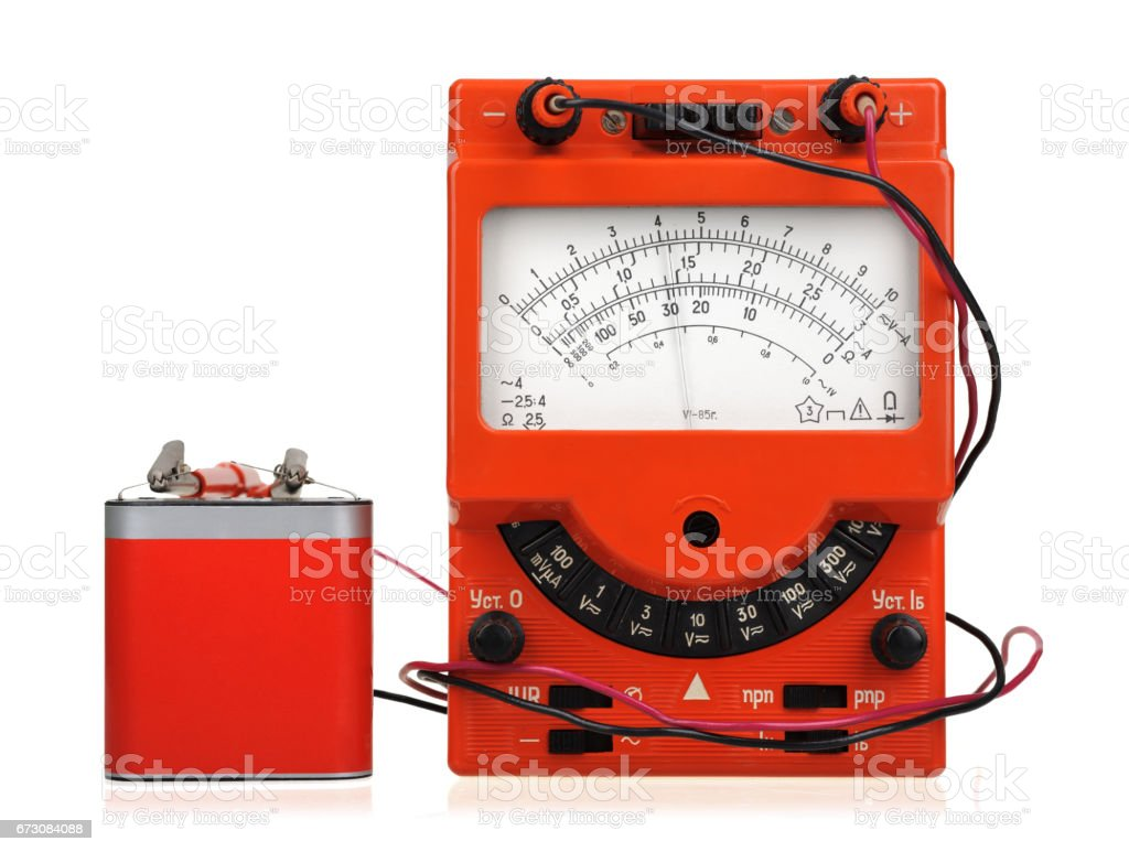 Analog vintage multimeter in box isolated on white stock photo