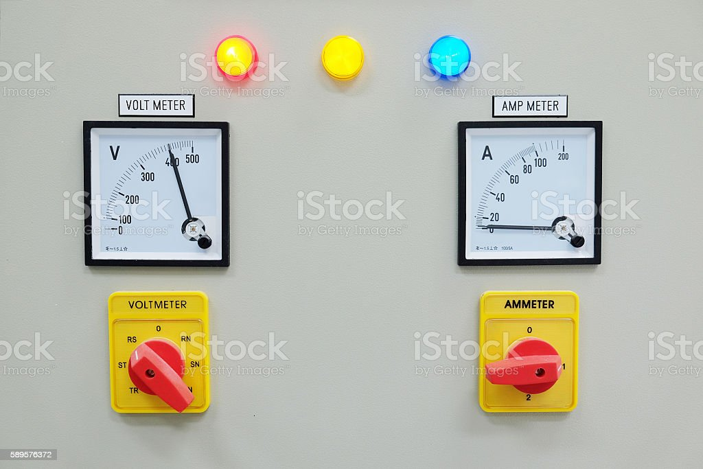 Analog voltmeter, amp meter and signal lamp stock photo