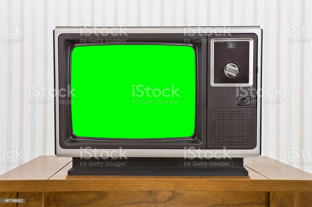 Analogue Portable Television on Table with Green Screen stock photo