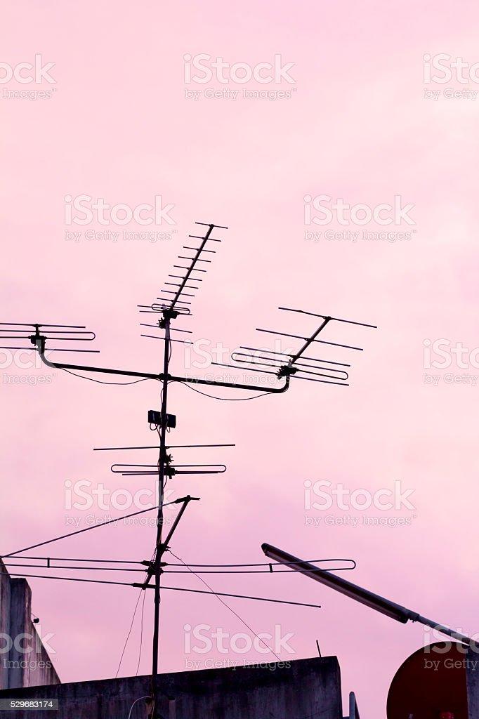 Analogue TV antenna silhouette stock photo