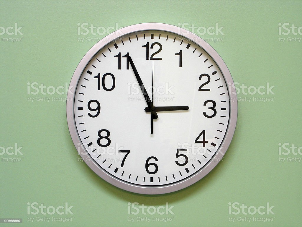Analogue wall clock with black detail on white royalty-free stock photo