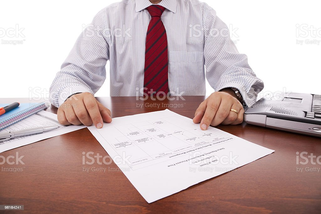 Analysing a flowchart document royalty-free stock photo
