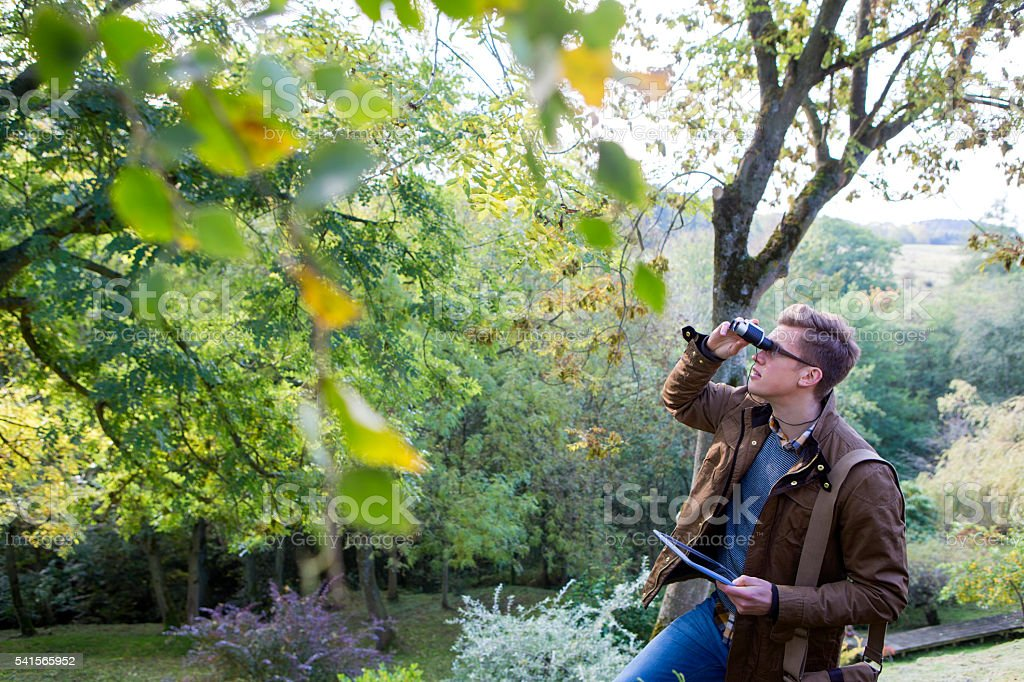 Analysing Nature with Binoculars stock photo