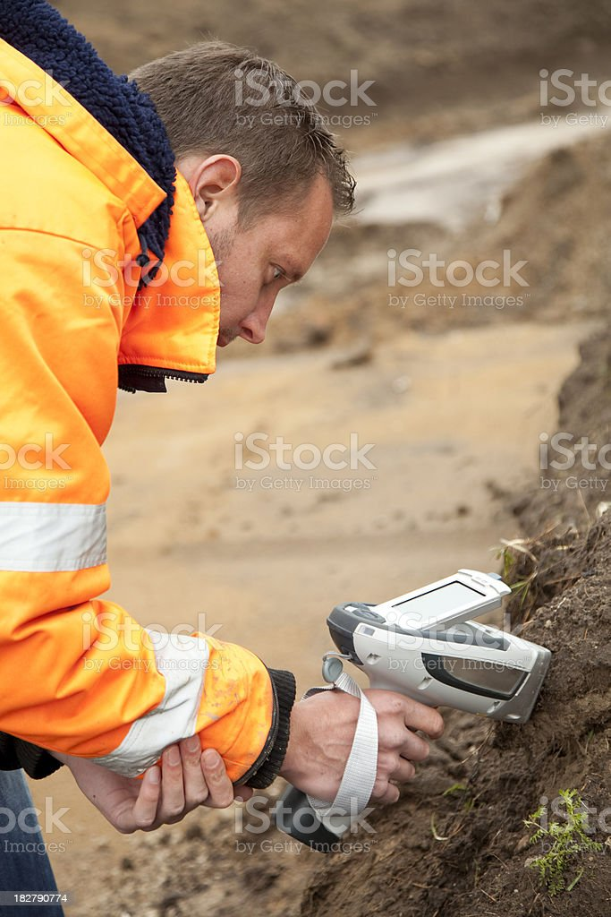 Analysing the soil and taking samples, environmetal research. stock photo