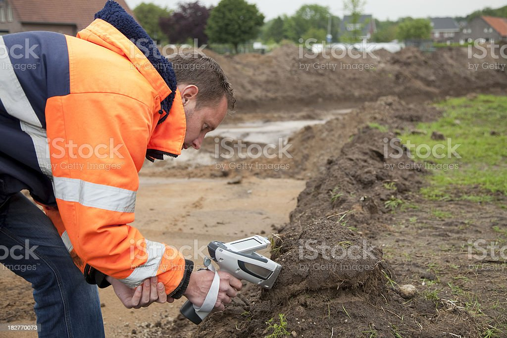 Analysing the soil with HXRF and taking samples, environmetal research. stock photo